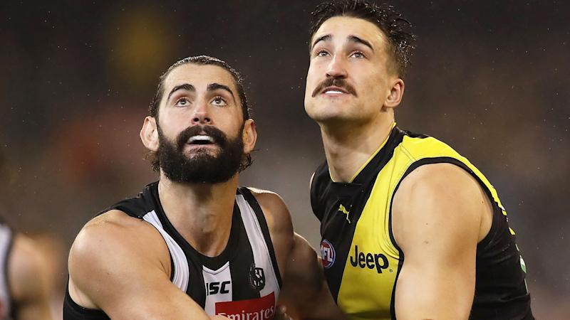 Pictured here, Collingwood and Richmond in action in the AFL.
