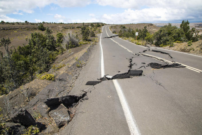 This photo provided by the National Park Service shows earthquake damage to Crater Rim Drive inside Hawaii Volcanoes National Park in Hawaii on Friday, Aug. 17, 2018. Slowing activity at Hawaii's Kilauea volcano is prompting scientists to downgrade their alert level for the mountain. (Janice Wei/National Park Service via AP)