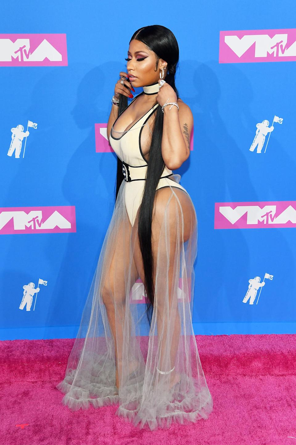 <p>The singer trialled the near-naked trend of 2018 at the VMAs with a hip-grazing leotard and ruffled (totally sheer) skirt by Off-White. <em>[Photo: Getty]</em> </p>