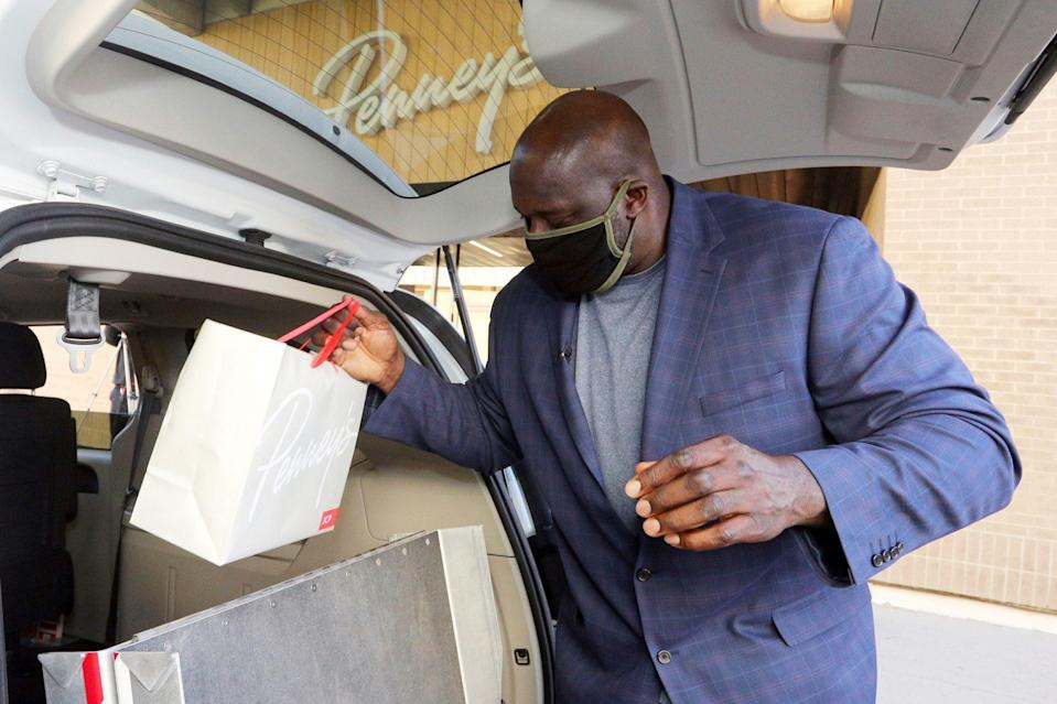 <p>JCPenney Big & Style Ambassador Shaquille O'Neal celebrates Giving Tuesday by delivering donated gifts via curbside pickup to Communities In Schools of North Texas families on Tuesday at the brand's store in Hurst, Texas.</p>