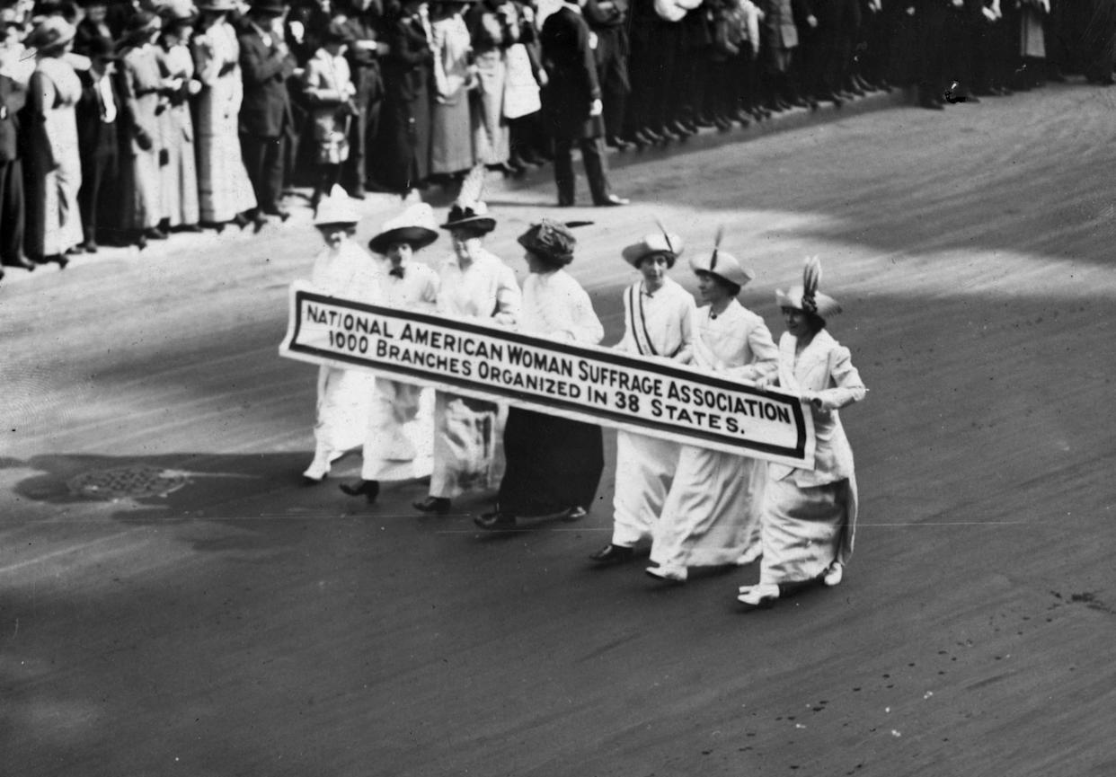 Members of the National American Woman Suffrage Association marching with a banner which publicizes their '1000 branches organized in 38 states' at the New York Suffragette Parade on May 3, 1913.