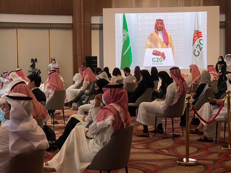 Saudi Crown Prince Mohammed bin Salman's speech is aired live at the media centre of the 15th annual G20 Leaders' Summit in Riyadh