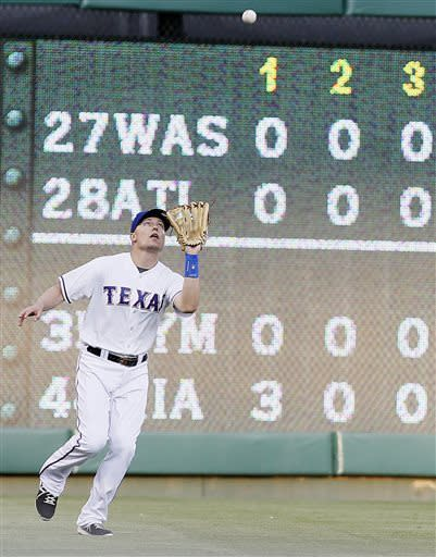 Texas Rangers right fielder Jeff Baker catches a fly-out hit by Chicago White Sox's Jeff Keppinger in the first inning of a baseball game in Arlington, Texas, Wednesday, May 1, 2013. (AP Photo/Brandon Wade)