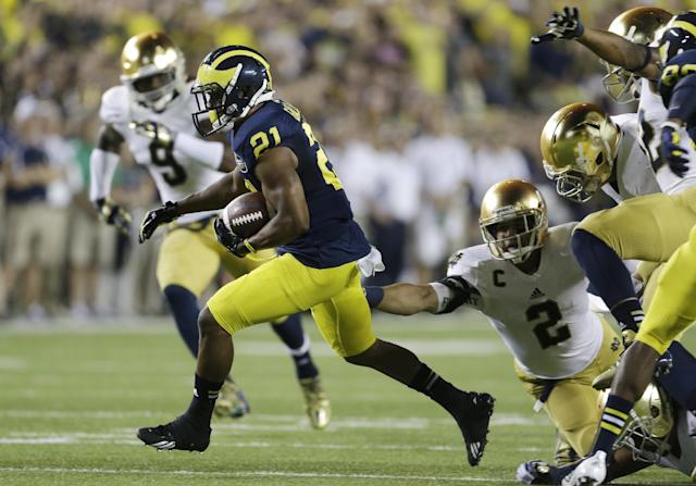 Michigan wide receiver Jeremy Gallon (21) pulls away from Notre Dame cornerback Bennett Jackson for a touchdown during the first quarter of an NCAA college football game in Ann Arbor, Mich., Saturday, Sept. 7, 2013. (AP Photo/Carlos Osorio)