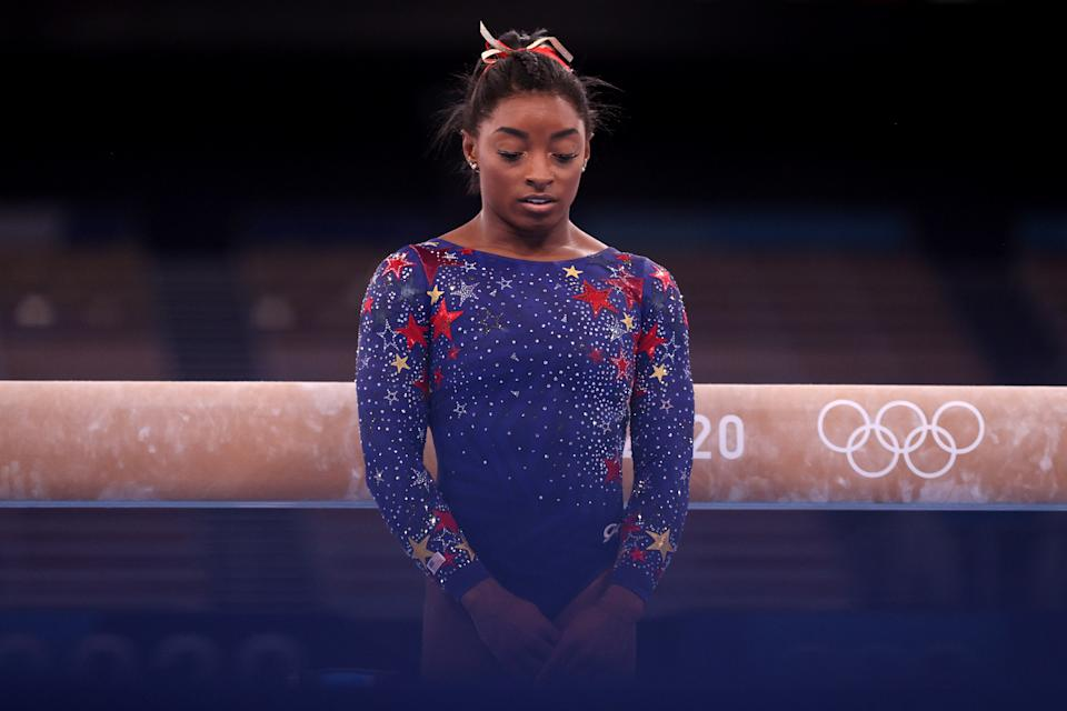 TOKYO, JAPAN - JULY 25: Simone Biles of Team United States looks on during Women's Qualification on day two of the Tokyo 2020 Olympic Games at Ariake Gymnastics Centre on July 25, 2021 in Tokyo, Japan. (Photo by Ezra Shaw/Getty Images)