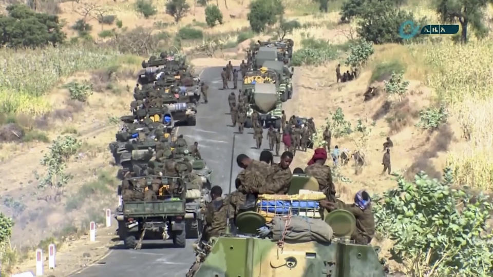 "This image made from undated video released by the state-owned Ethiopian News Agency on Monday, Nov. 16, 2020 shows Ethiopian military gathered on a road in an area near the border of the Tigray and Amhara regions of Ethiopia. Ethiopia's prime minister Abiy Ahmed said in a social media post on Tuesday, Nov. 17, 2020 that ""the final and crucial"" military operation will launch in the coming days against the government of the country's rebellious northern Tigray region. (Ethiopian News Agency via AP)"