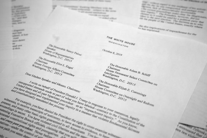 """A letter from White House counsel Pat Cipollone is photographed in Washington, on Tuesday, Oct. 8, 2019. The White House declared it will not cooperate with what it termed the """"illegitimate"""" impeachment probe by House Democrats, sharpening the constitutional clash between President Donald Trump and Congress. Trump attorneys sent a letter to House leaders bluntly stating their refusal to participate in the quickly moving impeachment investigation. (AP Photo/Jon Elswick)"""