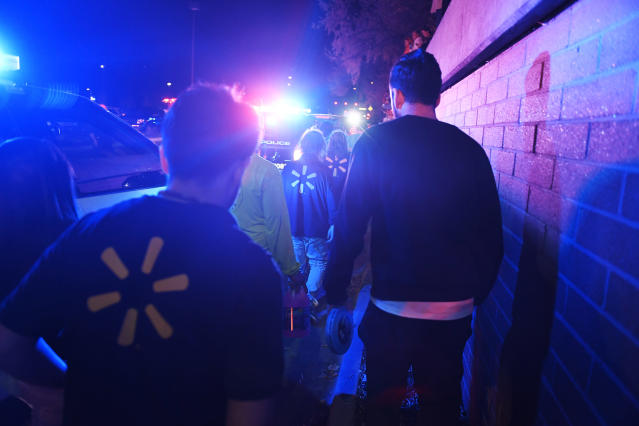 <p>Employees exit the parking lot after a gunman opened fire near the Halloween section of Walmart at 99th and Grant Street in Thornton, Colo. (Photo: Aaron Ontiveroz/The Denver Post via Getty Images) </p>