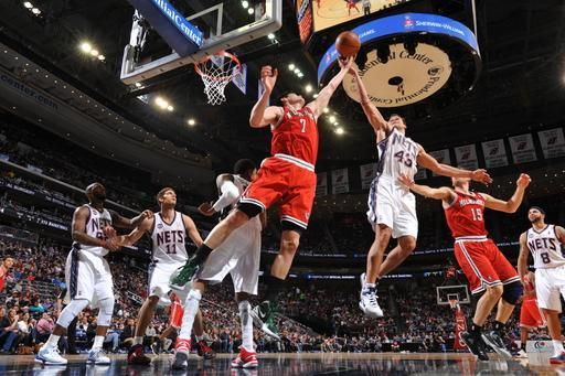 NEWARK, NJ - FEBRUARY 19: Ersan Ilyasova #7 of the Milwaukee Bucks goes up for the rebound against Kris Humphries #43 of the New Jersey Nets on February 19, 2012 at the Prudential Center in Philadelphia, Pennsylvania. (Photo by Jesse D. Garrabrant/NBAE via Getty Images)