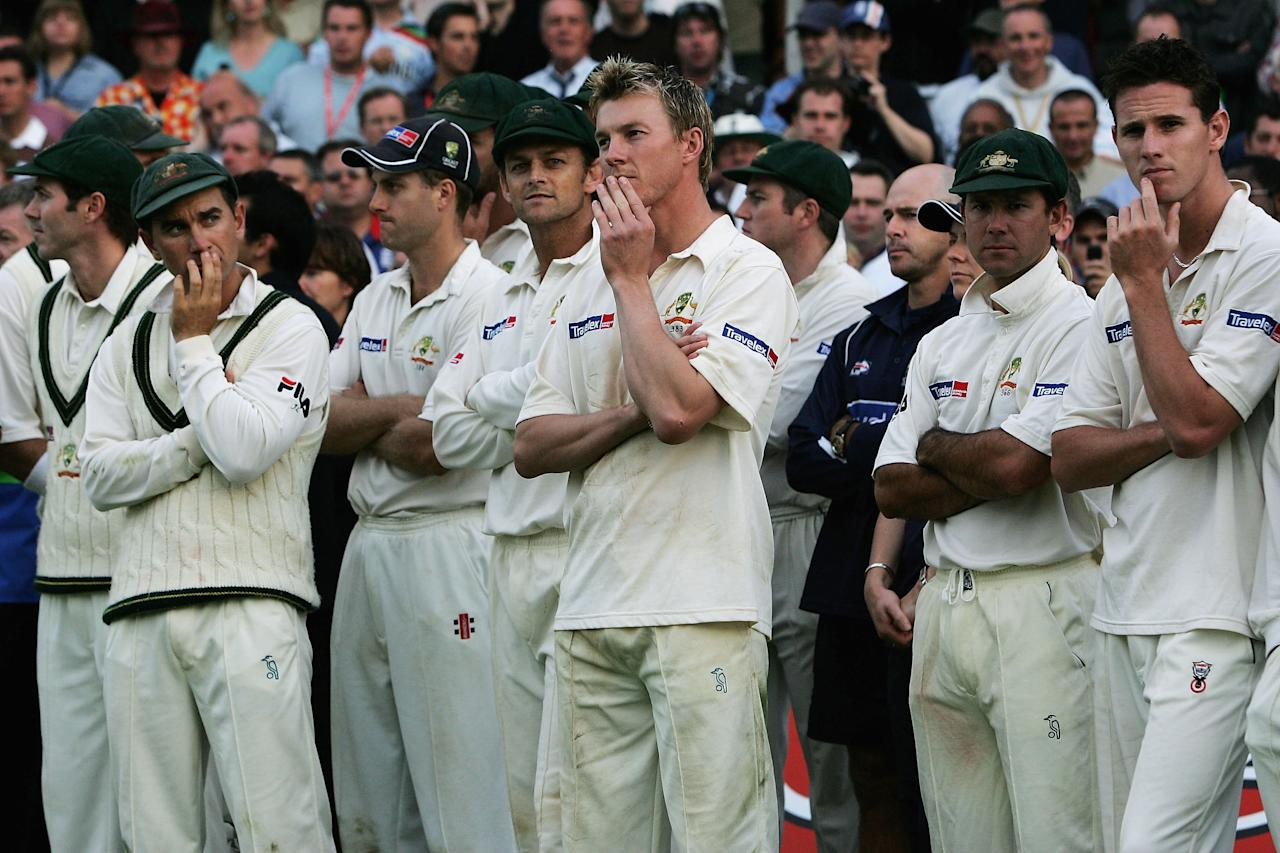 LONDON - SEPTEMBER 12: Members of the Australian team look dejected after England regained the Ashes during day five of the Fifth npower Ashes Test match between England and Australia at the Brit Oval on September 12, 2005 in London, England.  (Photo by Tom Shaw/Getty Images)