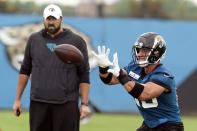 Jacksonville Jaguars tight end Tim Tebow, right, catches a pass during an NFL football practice, Monday, June 14, 2021, in Jacksonville, Fla. (AP Photo/John Raoux)