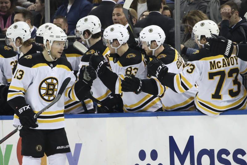 Boston Bruins center Charlie Coyle (13) celebrates after scoring a goal during the second period of an NHL hockey game against the New York Rangers, Sunday, Feb. 16, 2020, at Madison Square Garden in New York. (AP Photo/Mary Altaffer