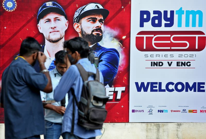 Members of media stand outside a stadium where India and England play their first test cricket match, in Chennai