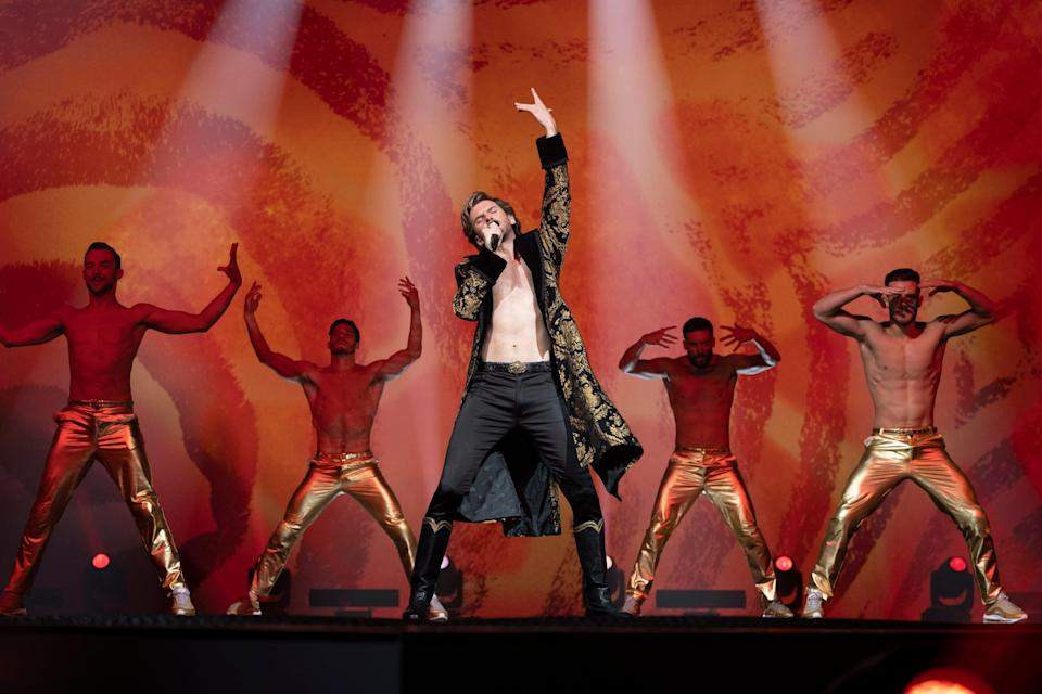 "Dan Stevens transforms as shirt-loathing Russian contestant Alexander Lemtov in ""Eurovision."" Says director David Dobkin, ""He was in shape, but when he got the role, he texted me, saying, 'I'm going into the gym right now.' """