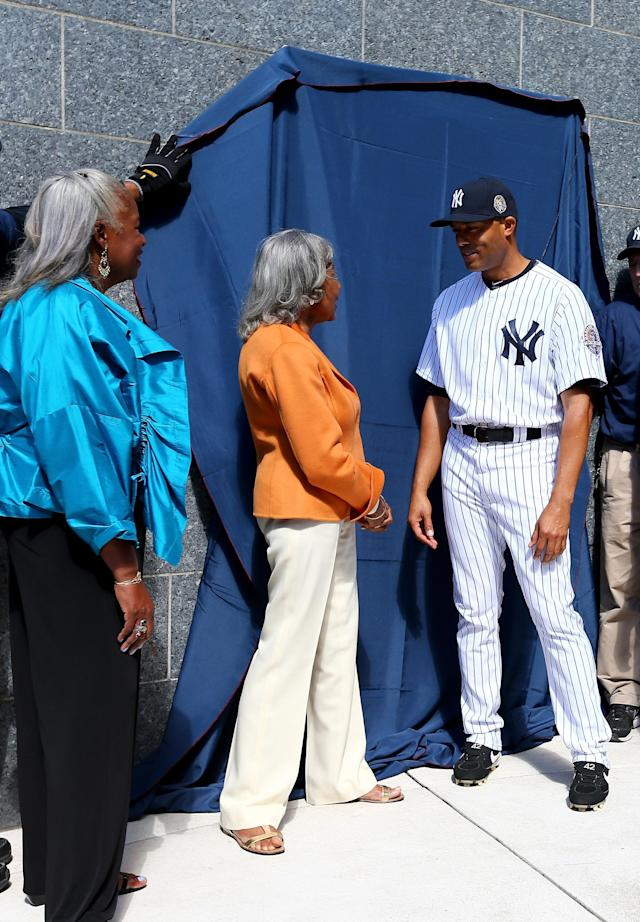 NEW YORK, NY - SEPTEMBER 22: Mariano Rivera #42 of the New York Yankees and the wife and daughter of Jackie Robinson, Rachel Robinson (R) and Sharon Robinson (L) watch as a plaque is unveiled in Monument Park prior to the game against the San Francisco Giants during interleague play on September 22, 2013 at Yankee Stadium in the Bronx borough of New York City. (Photo by Elsa/Getty Images)