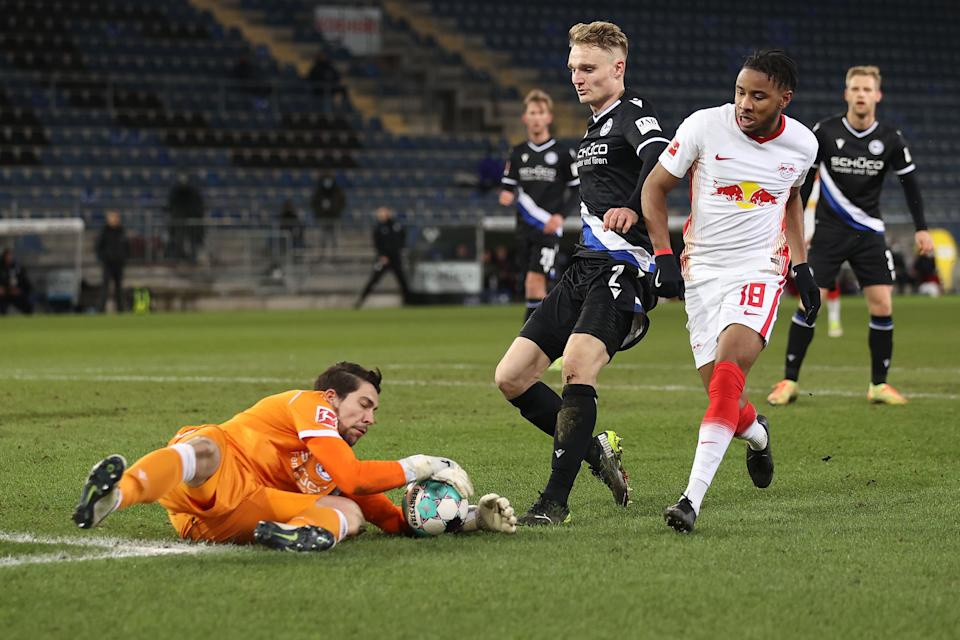 BIELEFELD, GERMANY - MARCH 19: Stefan Ortega Moreno, keeper of Bielefeld safes the ball with his team mate Amos Pieper against Christopher Nkunku of Leipzig during the Bundesliga match between DSC Arminia Bielefeld and RB Leipzig at Schueco Arena on March 19, 2021 in Bielefeld, Germany. (Photo by Lars Baron/Getty Images)