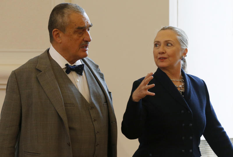 Czech Republic's Foreign Minister Karel Schwarzenberg, left, and US Secretary of State Hillary Rodham Clinton, right, arrive for their press conference in Prague, Czech Republic, Monday, Dec. 3, 2012.  Secretary of State Clinton is lobbying the Czech Republic authorities to approve an American contract bid for an expansion of a nuclear power plant. (AP Photo/Petr David Josek)
