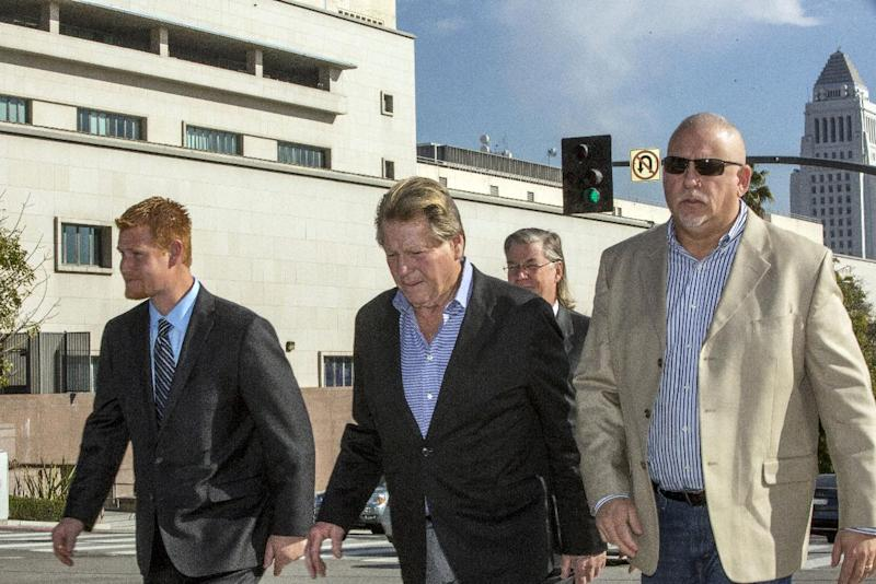 Redmond O'Neal, left, Ryan O'Neal, center, and an unidentified man leave court for a lunch break on Thursday, Dec. 12, 2013, in Los Angles. Attorneys for O'Neal concluded their case in the actor's bid to keep a version of an Andy Warhol portrait of his longtime partner Farrah Fawcett. The former couple's son Redmond O'Neal was among the final witnesses. (AP Photo/Damian Dovarganes)