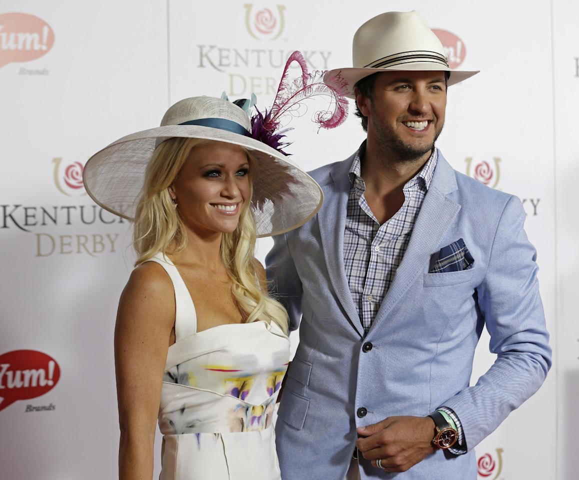 Country singer Luke Bryan arrives with his wife Caroline to attend the 139th Kentucky Derby at Churchill Downs Saturday, May 4, 2013, in Louisville, Ky. (AP Photo/Darron Cummings)