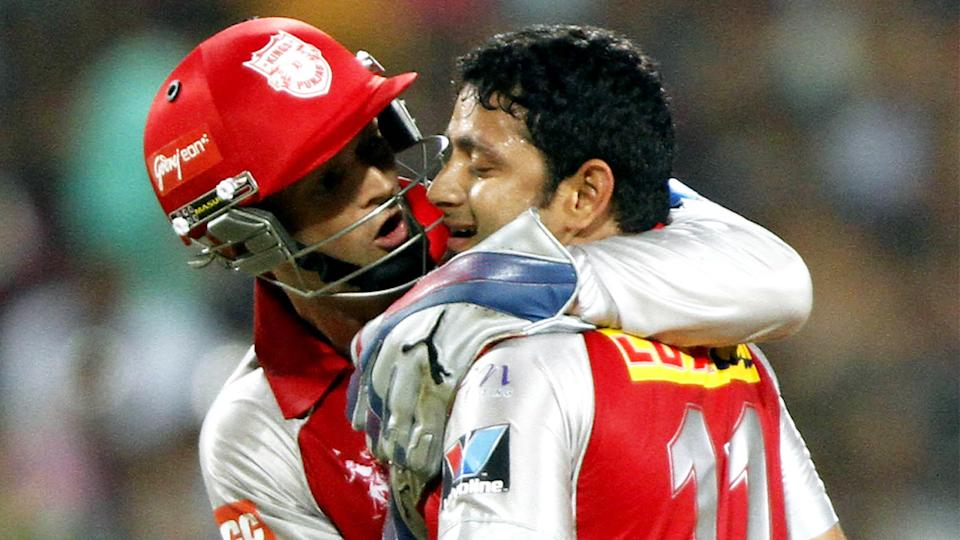 Adam Gilchrist (pictured left) hugs Piyush Chawla (pictured right) after a wicket in the IPL.