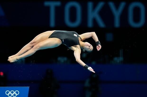 Canada's Meaghan Benfeito failed to advance to the final of the women's 10-metre platform diving event at Tokyo 2020, finishing just one spot away from qualifying. (Dmitri Lovetsky/The Associated Press - image credit)