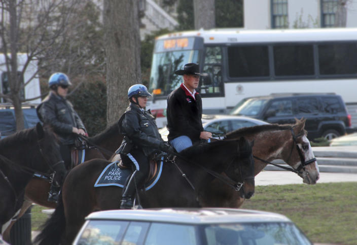 Zinke arrives for his first day of work aboard a horse named Tonto. (Photo: Interior Department via AP)