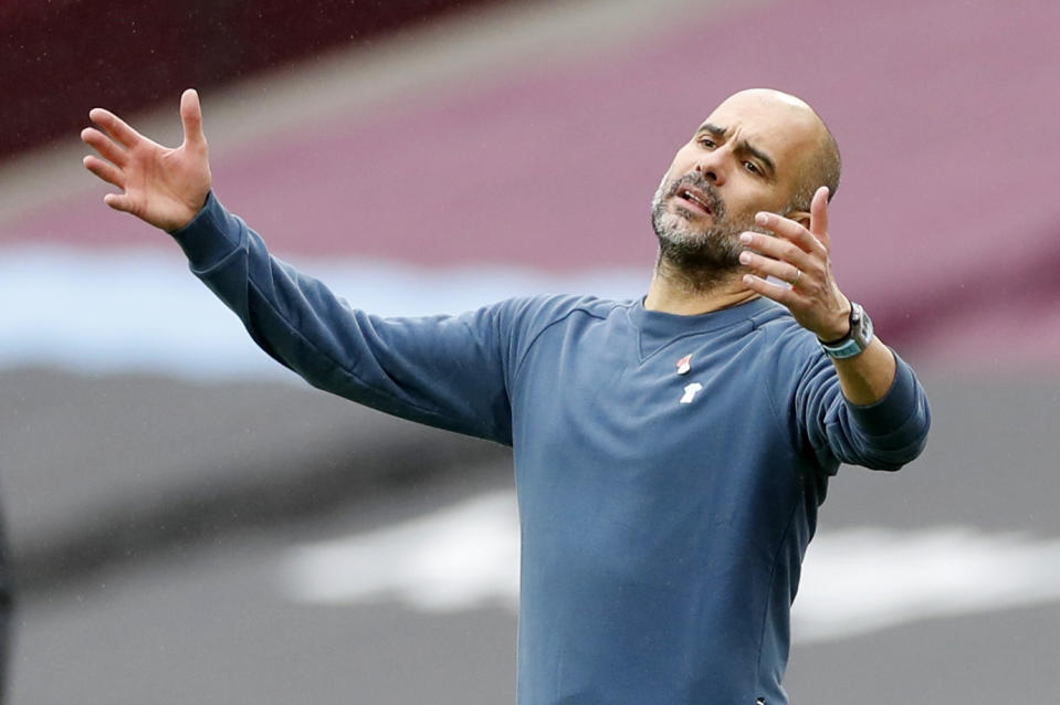 Manchester City manager Pep Guardiola looks dejected in their match against West Ham.