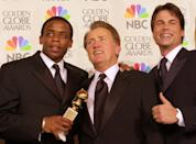 """From left, Dule Hill, Martin Sheen and Rob Lowe display the best drama television series award won by """"The West Wing"""" at the 58th Annual Golden Globe Awards in Beverly Hills, Calif., Sunday, Jan. 21, 2001. Sheen also won best actor in a dramatic television series for the same show. (AP Photo/Kevork Djansezian)"""