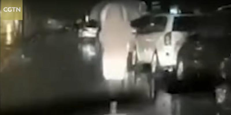 husband drives behind his wife as she walks to wuhan hospital at night