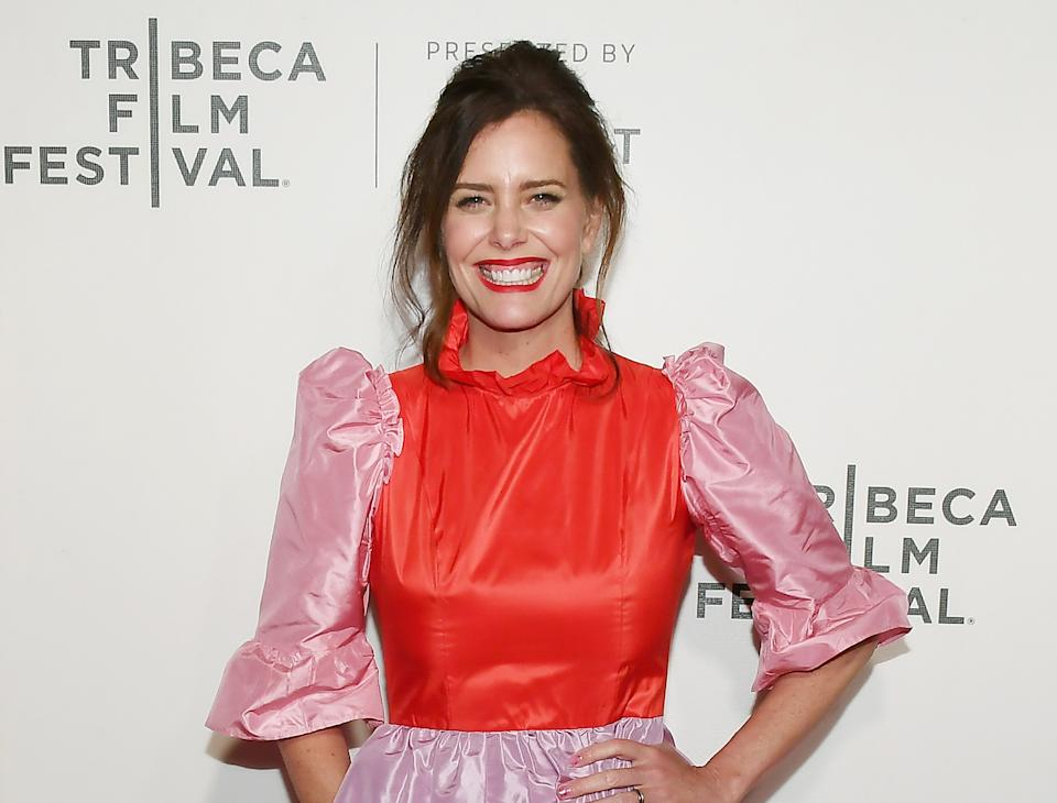 Actress Ione Skye wears a pink and red dress at the screening of