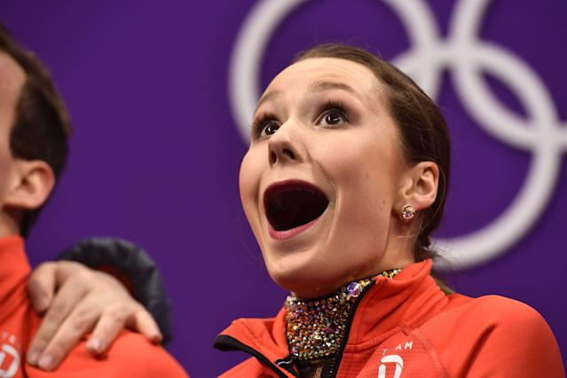 <p>Germany's Annika Hocke (pictured) and Germany's Ruben Blommaert react after competing in the pair skating short program of the figure skating event during the Pyeongchang 2018 Winter Olympic Games at the Gangneung Ice Arena in Gangneung on February 14, 2018. / AFP PHOTO / ARIS MESSINIS </p>