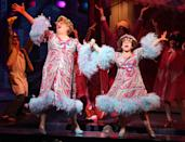 <p>You can't stop the beat of this story, which follows Tracey Turnblad on her quest to achieve musical fame and equality in a segregated 1960s Baltimore. Marissa Jaret Winokur donned the giant wig as the lead during the original production. The show has experienced a unique pattern of flowing from film to stage, then to film again. Based on John Water's 1988 classic of the same name, <em>Hairspray</em> ran on Broadway from 2002–2009–during which it was remade into a film again in 2007.</p>