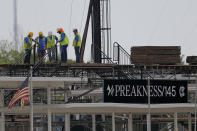 FILE - In this May 15, 2020, file photo, a crew works on putting up a platform near the main entrance at Pimlico Race Course in Baltimore. Pimlico, which opened in 1870, is set to be rebuilt over the next two-plus years. (AP Photo/Julio Cortez, File)