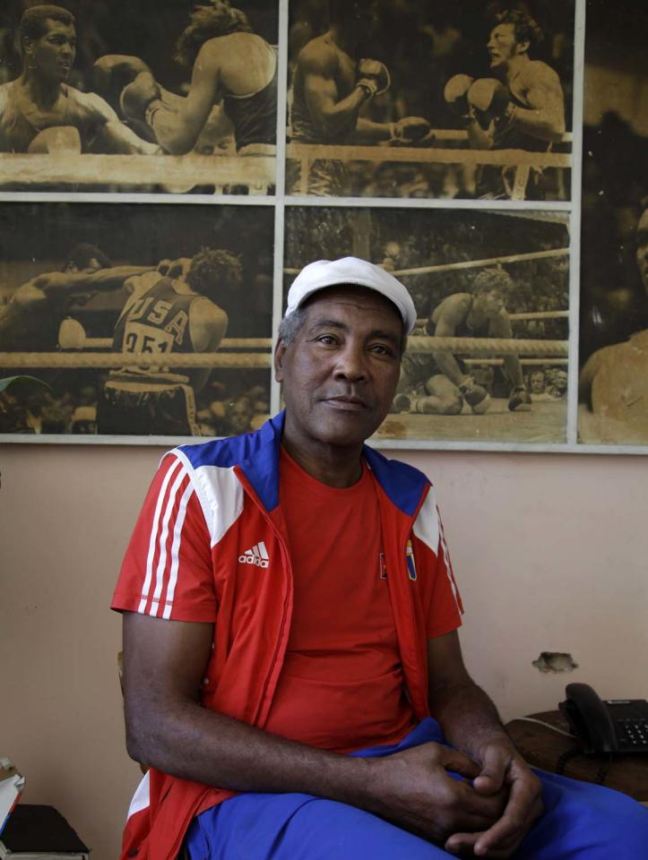 FILE - In this Feb. 1, 2012, file photo Cuba's three-time Olympic heavyweight boxing champion Teofilo Stevenson poses for a picture during an interview at his home in Havana, Cuba. Stevenson died on Monday, June 11, 2012, at the age of 60. (AP Photo/Javier Galeano, file)