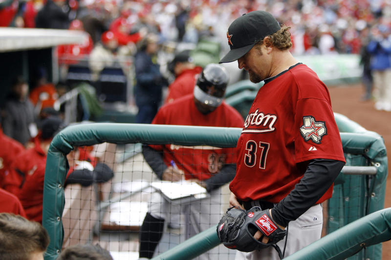 Houston Astros' Brandon Lyon goes into the dugout after giving up the game-winning RBI-single by Philadelphia Phillies' John Mayberry Jr.  in the ninth inning of a baseball game, Friday, April 1, 2011, Philadelphia. The Phillies won 5-4.(AP Photo/Matt Rourke)