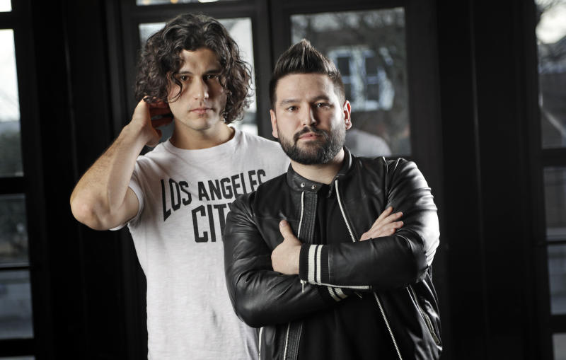 FILE - In this Jan. 31, 2019 file photo, Dan Smyers, left, and Shay Mooney, of the duo Dan + Shay, pose in Nashville, Tenn. In nominations announced Thursday, Feb. 27, 2020, the Grammy-winning duo lead the 2020 Academy of Country Music Awards with six nominations for Smyers and five for Mooney and helped pop star Justin Bieber earn his first-ever ACM noms.  (AP Photo/Mark Humphrey, File)