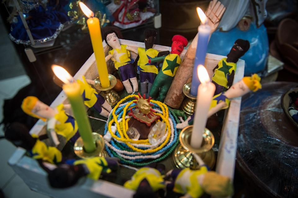 Small dolls representing Brazil's national football players set inside a special box to enhance power and luck on them as part of the Afro-Brazilian religious ritual, in Rio de Janeiro, Brazil, on July 3, 2014 (AFP Photo/Yasuyoshi Chiba)