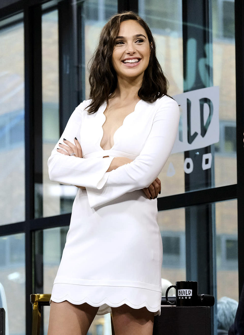 <p>Gadot rocked a white, above-the-knee design from A.L.C., with a plunging neckline and scalloped edges, to AOL's Build Studios NYC. Her black manicure added a funky vibe. (Photo: Evan Agostini/Invision/AP) </p>