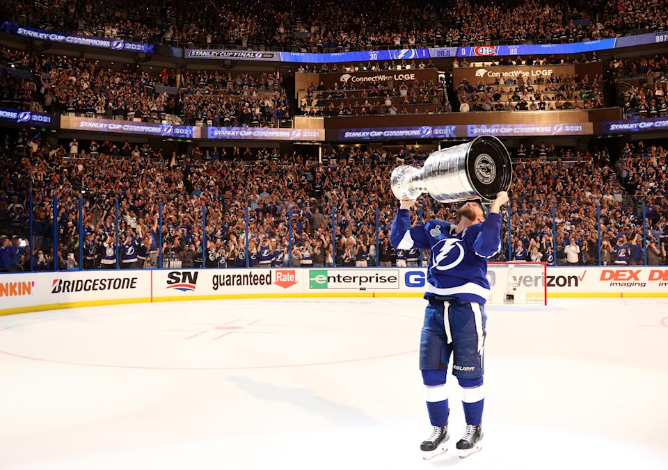 TAMPA, FLORIDA - JULY 07: Steven Stamkos #91 of the Tampa Bay Lightning kisses the Stanley Cup after their 1-0 win in Game Five of the 2021 Stanley Cup Final to win the series four games to one against the Montreal Canadiens at Amalie Arena on July 07, 2021 in Tampa, Florida. (Photo by Florence Labelle/NHLI via Getty Images)