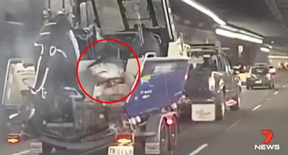 Motorists were baffled to spot the shark hanging from the back of the men's boat. Source: 7News