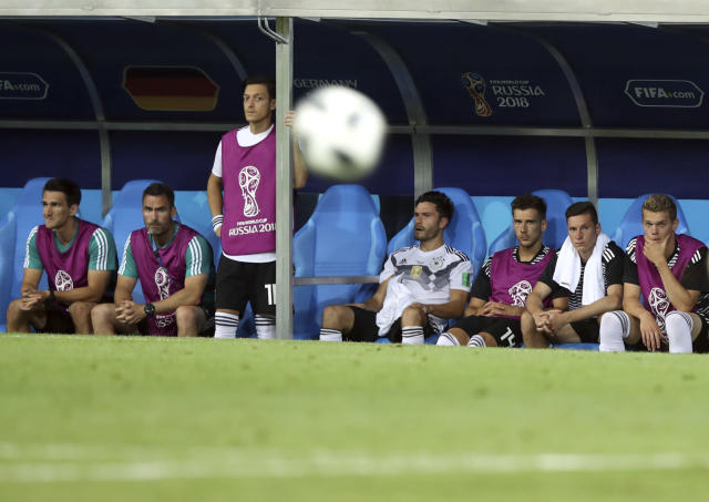 FILE - In this June 23, 2018 file photo Germany's Mesut Ozil, third from left, looks out from the bench during the group F match between Germany and Sweden at the 2018 soccer World Cup in the Fisht Stadium in Sochi, Russia. (AP Photo/Thanassis Stavrakis, file)