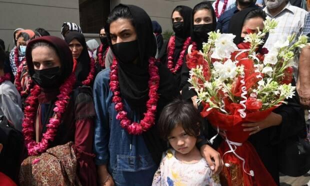 Members of Afghanistan's national junior women's soccer team arrive at the Pakistan Football Federation (PFF) in Lahore on September 15. They fled the country after the Taliban retook power, and banned women from playing all sports.  (Arif Ali/AFP via Getty Images - image credit)