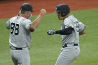 New York Yankees' Gio Urshela, right, celebrates his two-run home run off Tampa Bay Rays starting pitcher Michael Wacha with third base coach Phil Nevin during the third inning of a baseball game Sunday, April 11, 2021, in St. Petersburg, Fla. (AP Photo/Chris O'Meara)