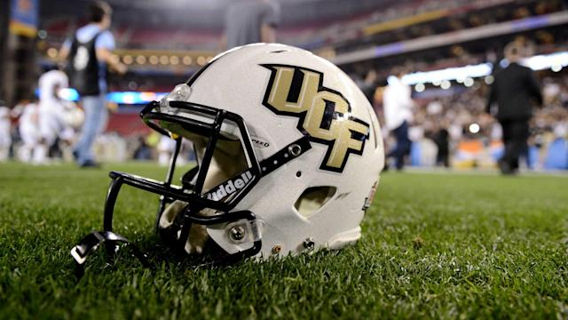 Central Florida stays undefeated with win over South Florida but got no love in the penultimate CFP rankings. (AP)