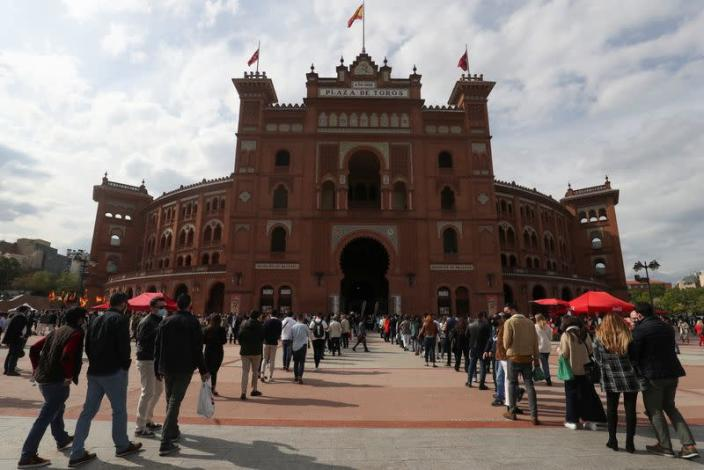 People wait outside Las Ventas bullring ahead of the first bullfight since the start of the COVID-19 pandemic, in Madrid