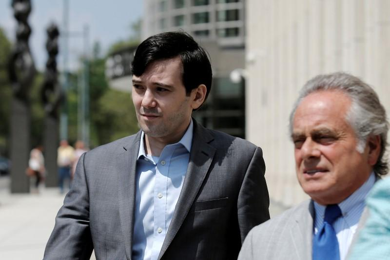 Shkreli departs with his attorney Brafman following a hearing at U.S. Federal Court in Brooklyn, New York