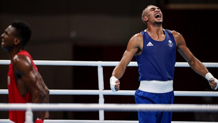 Benjamin Whittaker R of Britain celebrates winning the boxing men's light heavy 75-81kg quarterfinal match against Keno Machado of Brazil at Tokyo 2020 Olympic Games in Tokyo, Japan, July 30, 2021. (Photo by Ou Dongqu/Xinhua via Getty Images)