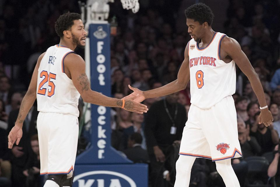 Derrick Rose and Justin Holiday have settled in nicely in New York. (AP)