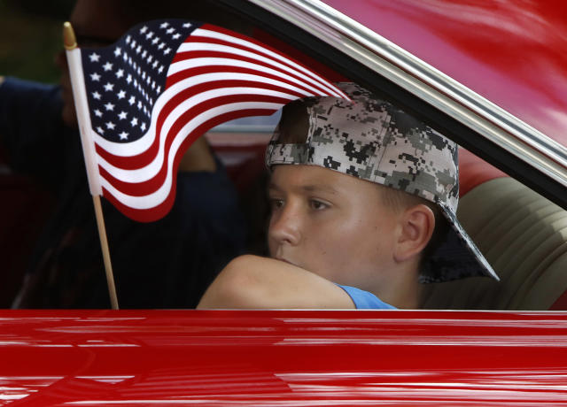 <p>A boy rides in a classic Impala during the annual Fourth of July Parade, in Micanopy, Fla., Tuesday, July 4, 2017. (Photo: Brad McClenny/The Gainesville Sun via AP) </p>
