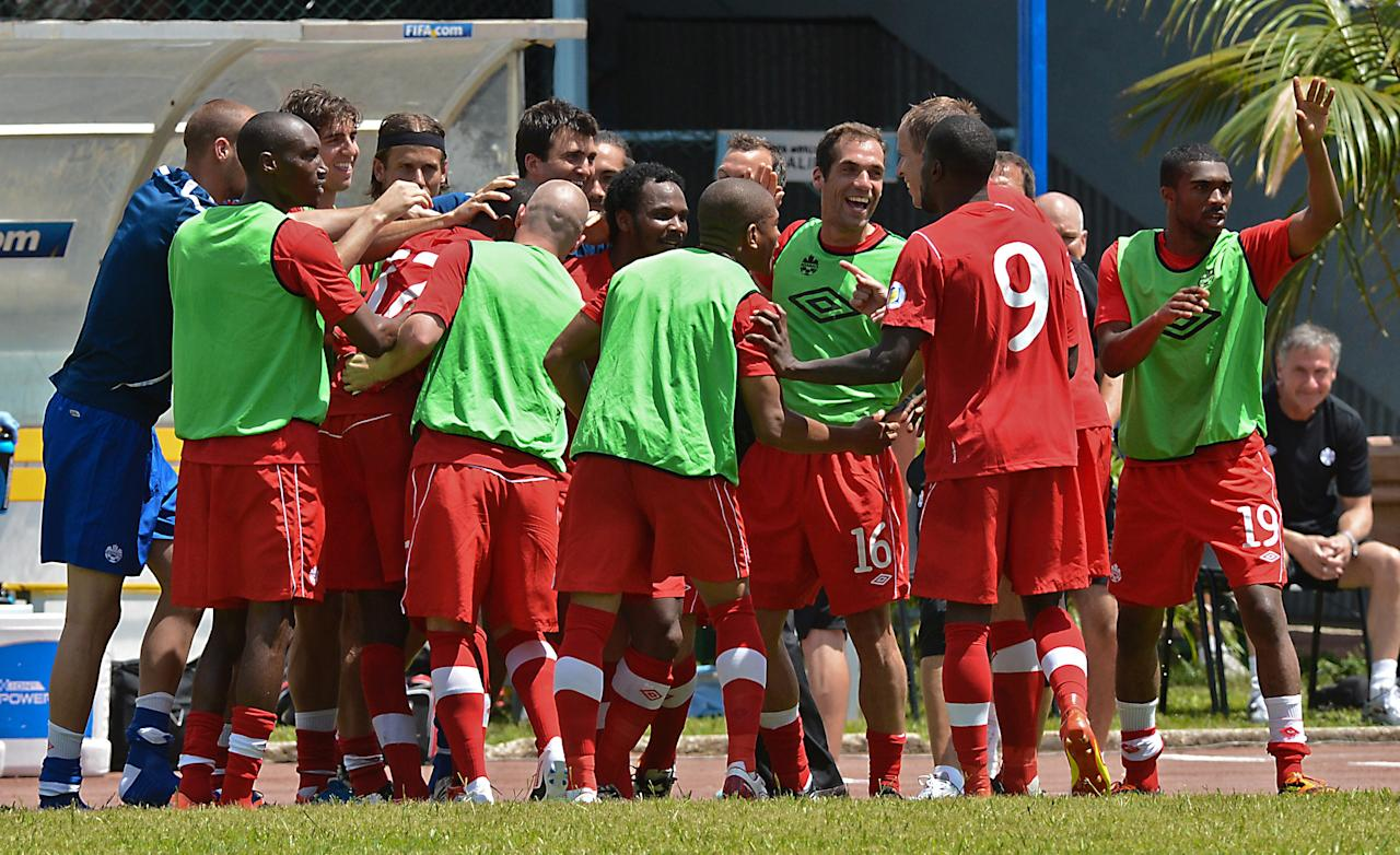 Canadian national football team's players celebrate the goal of Olivier Occean during their FIFA World Cup Brazil 2014 CONCACAF qualifier match against Cuba at the Pedro Marrero stadium in Havana on June 8, 2012.  Canada won 1-0.      AFP PHOTO/ADALBERTO ROQUEADALBERTO ROQUE/AFP/GettyImages